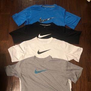 Set of 4. Boys size XL Nike Dri-fit shirts.